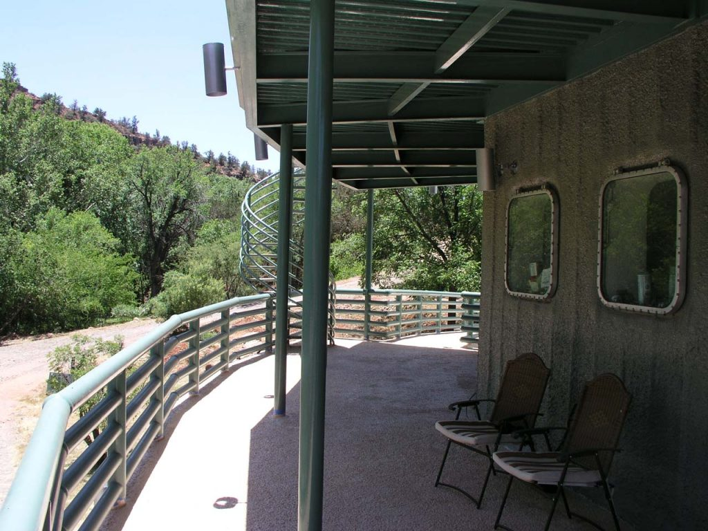 COVERED DECK AT SECOND LEVEL