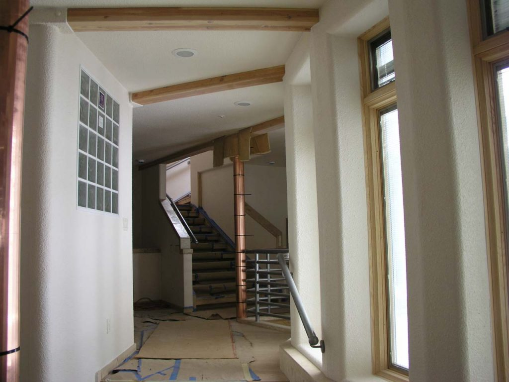STAIRS FROM LOWER LEVEL TO FORMAL ENTRY